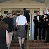 MARIA UMINSKI/SALEM NEWS Fran Page, Steve O'Connell, Irwin Cohen and Charlie Coogan of the barbershop quartet, The Essex County 4, serenade guests as they make their way into the Danvers Family Festival kick-off event, Horray for Hollywood at the Danversport Yacht Club on Friday night.