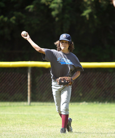 Danvers National All-Star Ben Condon fields the ball and throws to third during practice at Tapley Field in Danvers on Thursday afternoon. DAVID LE/Staff photo. 6/19/14.