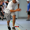 Danvers High School junior captain elect Cris Valles crosses over during an agility drill on Wednesday afternoon. DAVID LE/Staff photo. 6/18/14.