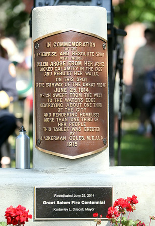 A refurbished and rededicated memorial for the Great Salem Fire of 1914 sat behind the podium during a commemoration ceremony on Wednesday afternoon. DAVID LE/Staff photo. 6/25/14.