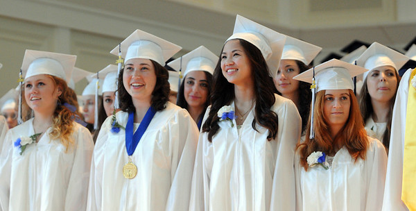 KEN YUSZKUS/Staff photo. Graduates share a laugh during the Hamilton-Wenham graduation at Gordon College Chapel.   6/1/14.