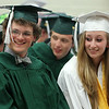 Essex Aggie graduates Robert Craig and Nicole Langlois smile while talking with classmates prior to marching into the final Commencement ceremony for the Essex Agricultural and Technical High School. Next year Essex Aggie and North Shore Technical High School will combine into one school. DAVID LE/Staff photo. 6/5/14.