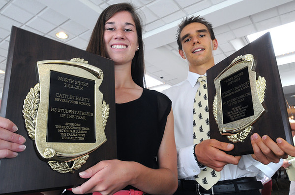 KEN YUSZKUS/Staff photo.  Student-Athlete of the Year winners Caitlin Harty of Beverly High School and Everest Crawford of Gloucester High School hold their awards. 6/10/14.