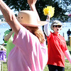 MARIA UMINSKI/SALEM NEWS Glenys Szcuka cheer son walkers at the beginning of the North Shore Cancer on Sunday June 22, 2014.