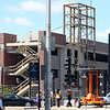 Work on the new parking garage at the MBTA Commuter Rail Station in downtown Salem is progressing at a rapid pace and the structure easily rises above street level as seen from Washington Street. DAVID LE/Staff photo. 6/20/14.