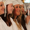 Essex Aggie graduates Ashley Boulanger, left, and Karli Brazis, right, smile while listening to the Valedictory Address given by Beverly resident Oona King, during the final Commencement ceremony for the Essex Agricultural and Technical High School. Next year Essex Aggie and North Shore Technical High School will combine into one school. DAVID LE/Staff photo. 6/5/14.