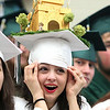 Essex Aggie graduate Marina Callahan tries to keep her creatively decorated graduation cap from falling off as all the Essex Agricultural and Technical High School graduates prepared to march into the final Commencement for the school. Next year Essex Aggie and North Shore Technical High School will combine into one school. DAVID LE/Staff photo. 6/5/14.
