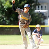 Danvers National All-Star Aaron Paskowski pump fakes a throw to third base during a rundown drill at practice at Tapley Field in Danvers on Thursday afternoon. DAVID LE/Staff photo. 6/19/14.