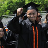KEN YUSZKUS/Staff photo. Graduate Mike Garcia turns his attention to the stands at Hurd Stadium while waiting for his fellow graduates to file in at the start of the Beverly High School graduation.   6/1/14.