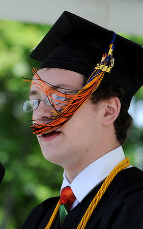 KEN YUSZKUS/Staff photo. The wind blows the tassle of salutatorian H. Tyler Visnick while he gives his speech during the Beverly High School graduation at Hurd Stadium .   6/1/14.