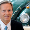 KEN YUSZKUS/Staff photo. President and CEO of the Kelly Automotive Group Brian Kelly is situated in front of a vintage VW bug.  6/13/14.