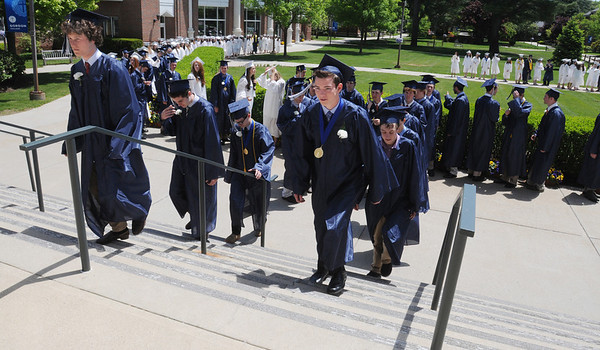 KEN YUSZKUS/Staff photo. Graduates Spencer Neff, left, and Ted Hogan lead the processional at Hamilton-Wenham graduation up the steps of the Gordon College Chapel.   6/1/14.