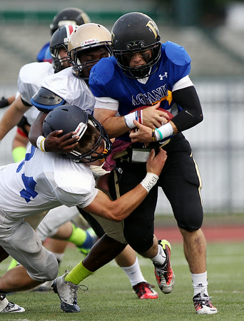 North quarterback Nick Bona (33) runs over South defensive back Matthew Kramich (24) during the first quarter of play. DAVID LE/Staff photo. 6/26/14.