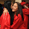 KEN YUSZKUS/Staff photo. Julianny Vittini, left, and Yanna Noboa hug as the graduates are assembling before the start of the Salem High School graduation.  6/6/14.