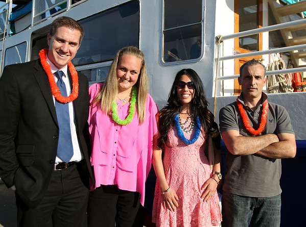 From left, Chad Hanson, Jill Granger, Micayla Peppe, and Stefano Vio, of Comfort Inn Danvers. at the North of Boston Convention and Visitors Bureau's Sail Into Summer Fundraiser aboard the Hannah Glover on Wednesday evening. DAVID LE/Staff photo. 6/18/14.