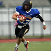 Bishop Fenwick quarterback Nick Bona finds some omen running room against the South in the 53rd Agganis football game on Thursday evening. DAVID LE/Staff photo. 6/26/14.