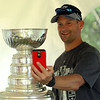 Chris Pulick takes a selfie with the Stanley Cup at the house of Mark Yanetti, of Topsfield on Sunday morning. Yanetti, the Director of Amateur Scouting for the Los Angeles Kings won the Cup for the second time in three years. DAVID LE/Staff photo. 6/29/14.
