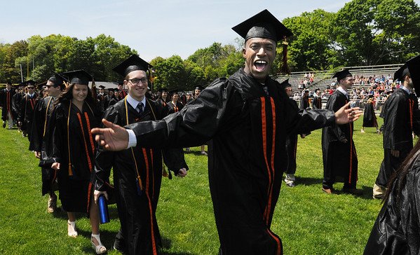 KEN YUSZKUS/Staff photo. Graduate Rashaud Alford appears happy as he marches during the processional onto the field at Hurd Stadium for the Beverly High School graduation.   6/1/14.