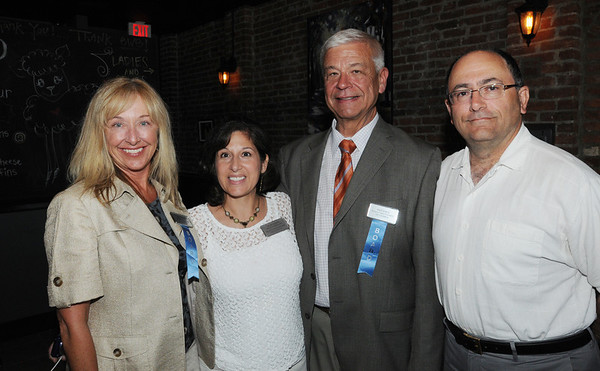 KEN YUSZKUS/Staff photo. From left, Kathy Boudreau of Circle Insurance, Maria Terris of the Peabody Chamber, Mike Sobus of Next Level BD, and Frank Scearbo of Serve First Solutions attend the Peabody Chamber of Commerce gathering at the newly opened Black Sheep Pub & Grille in Peabody.  6/2/14.