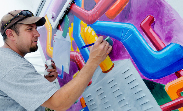 "KEN YUSZKUS/Staff photo. Scott Froeschl paints a utility box as part of the Salem's ArtBox program at the corner of Washington Street and Lafayette Street in Lafayette Park. The title of his painting is ""Inner Pieces"".    6/9/14."