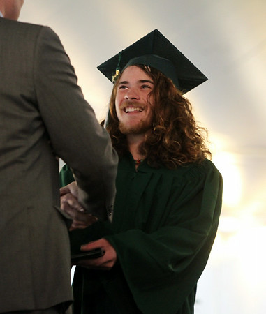 Essex Aggie graduate Kyle Hobby flashes a wide smile as he receives his diploma on Thursday evening during the final Commencement ceremony for the Essex Agricultural and Technical High School. Next year Essex Aggie and North Shore Technical High School will combine into one school. DAVID LE/Staff photo. 6/5/14.