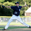 Hamilton-Wenham starting pitcher Will Jones fires a pitch against Danvers National in District 15 play on Monday evening. DAVID LE/Staff photo. 6/30/14.
