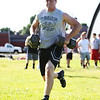 Masco soon-to-be senior Jack Butt runs towards the finish line while carrying weights during a drill of the Lineman Challenge at Masconomet Regional High School, a competition for local high school offensive and defensive linemen and run by Masco head football coach Jim Pugh. DAVID LE/Staff photo. 6/20/14.
