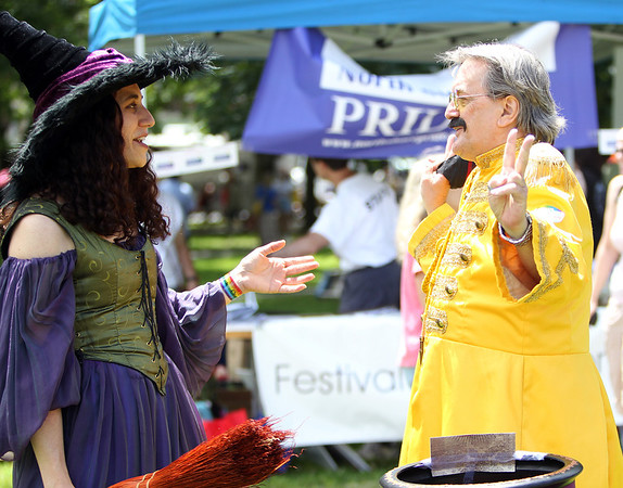 Laura Elizabeth, the Street Witch of Salem, left, talks with Dennis Castleton, right, of Boston at the annual Gay Pride Parade festivities at Salem Common on Saturday afternoon. DAVID LE/Staff photo. 6/21/14.