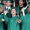 Salem Academy Charter School graduates Benjamin Phillips, Alex Thomas, and Jorge Reyes, clown around while taking a class picture prior to the start of graduation on Friday afternoon. DAVID LE/Staff photo. 4/13/14.