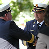 Danvers Fire Chief Kevin Farrell, right, shakes hands and receives a plaque of thanks from Salem Fire Chief David Cody, during a commemoration ceremony for the Great Salem Fire of 1914 on Wednesday afternoon. DAVID LE/Staff photo. 6/25/14.