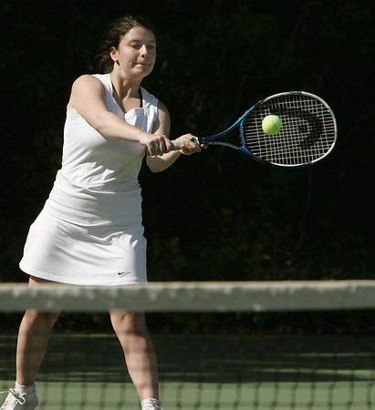 KEN YUSZKUS/Staff photo. Swampscott doubles player Sara Cunningham hits one back at the Austin Prep at Swampscott girls tennis state tournament match.  6/2/14.