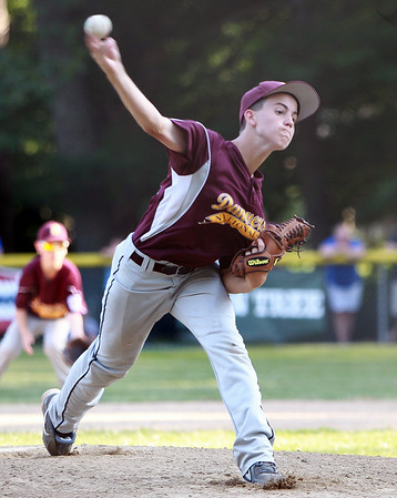Danvers National starting pitcher Mike Morrill fires a pitch against Hamilton-Wenham on Monday evening. DAVID LE/Staff photo. 6/30/14.