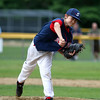Swampscott starting pitcher Ethan Weisse fires a pitch against Peabody West on Thursday evening. DAVID LE/Staff photo. 6/26/14.