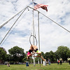 Performers Joanne Virginio and Juliet DeFrancisco, of Cape Cod perform a high flying duet act during the annual Gay Pride Parade festivities at Salem Common on Saturday afternoon. DAVID LE/Staff photo. 6/21/14.