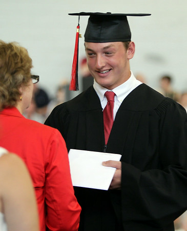 Marblehead High School graduate Liam Gillis receives his diploma on Sunday afternoon. DAVID LE/Staff photo. 6/8/14.
