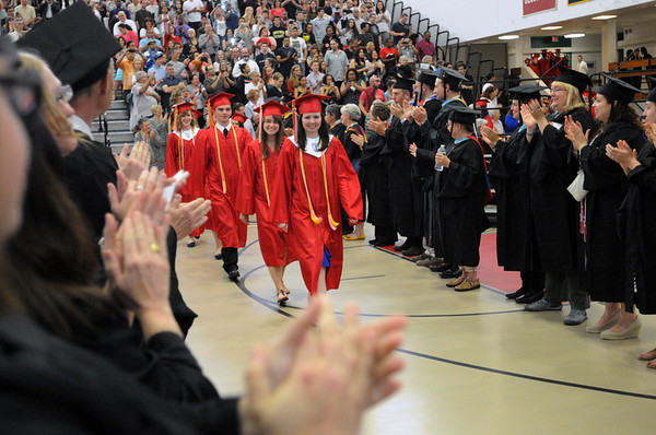 KEN YUSZKUS/Staff photo. The faculty applauds the graduates led by Emma Williamson during the processional of the Salem High School graduation.  6/6/14.