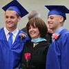 Danvers High School graduates Ryan Chasse, left, and Anthony Cordoba, right, pose for a photo with Principal Susan Ambrozavitch prior to the start of graduation on Saturday afternoon. DAVID LE/Staff photo. 6/7/14.