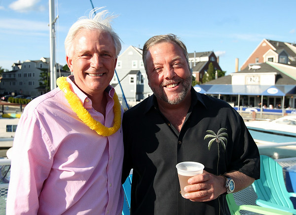 Steve Woodman, owner of Woodman's in Essex, left, and George Carey, owner of Finz in Salem at the North of Boston Convention and Visitors Bureau's Sail Into Summer Fundraiser aboard the Hannah Glover on Wednesday evening. DAVID LE/Staff photo. 6/18/14.
