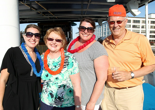 From left, Kristen Medler, Helen Medler and Martha Kelley, of Hawthorne Tours, and Rinus Oosthoek, Executive Director of the Salem Chamber of Commerce, at the North of Boston Convention and Visitors Bureau's Sail Into Summer Fundraiser aboard the Hannah Glover on Wednesday evening. DAVID LE/Staff photo. 6/18/14.