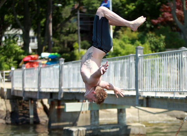 Chris Havens, of Marblehead, does a backflip into the water while trying to cool off on a hot Monday afternoon. DAVID LE/Staff photo. 6/30/14.