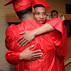 KEN YUSZKUS/Staff photo. Bryan Lora, left, and Shakir White hug as the graduates are assembling before the start of the Salem High School graduation.  6/6/14.