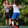 Bishop Fenwick rising junior captain Sydney Brennan looks to pass around Masco's Amy Fogarty on Monday evening. DAVID LE/Staff photo. 6/30/14.
