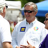 Congressman John Tierney, center, and his wife Patrice, right, talk with supporters during the annual Gay Pride Parade festivities at Salem Common on Saturday afternoon. DAVID LE/Staff photo. 6/21/14.