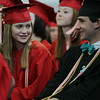 Marblehead High School graduates Anna VanRemoorten and Davis Franklin smile while waiting for the graduation activities to start on Sunday afternoon. DAVID LE/Staff photo. 6/8/14.