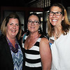 KEN YUSZKUS/Staff photo. From left, Lynn Feazel of AFLAC Insurance, Marisa Cole of Sensational Travel, and Michelle Talisman chairman of the Peabody Chamber of Commerce gather at the newly opened Black Sheep Pub & Grille in Peabody.  6/2/14.