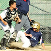Peabody Blue first baseman Declan Russell slides hard into West Lynn catcher Matt Devin on a force play at home plate. DAVID LE/Staff photo. 6/27/14.