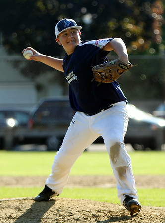 Peabody Blue starting pitcher Sean Letarte fires a pitch against West Lynn on Friday evening. DAVID LE/Staff photo. 6/27/14.