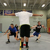 Under the direction of Danvers football coach Peter Spires, center, junior captain elect Richie Martino, left, and freshman Matt Andreas, right, split apart while doing a drill on Wednesday afternoon in preparation for the fall football season. DAVID LE/Staff photo. 6/18/14.