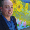 KEN YUSZKUS/Staff photo. Lifebridge's new director Jason Etheridge stands near the new mural. 6/3/14.