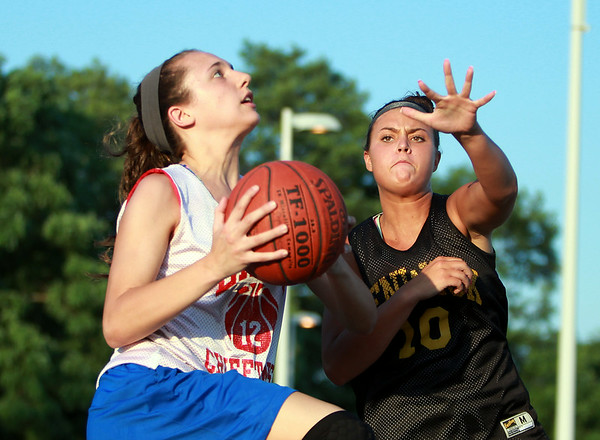 Masco's Amy Fogarty drives to the hoop while being defended by Bishop Fenwick's Lexi Rose on Monday evening. DAVID LE/Staff photo. 6/30/14.